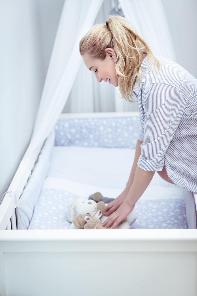 Какую кроватку нужно купить для новорожденного?